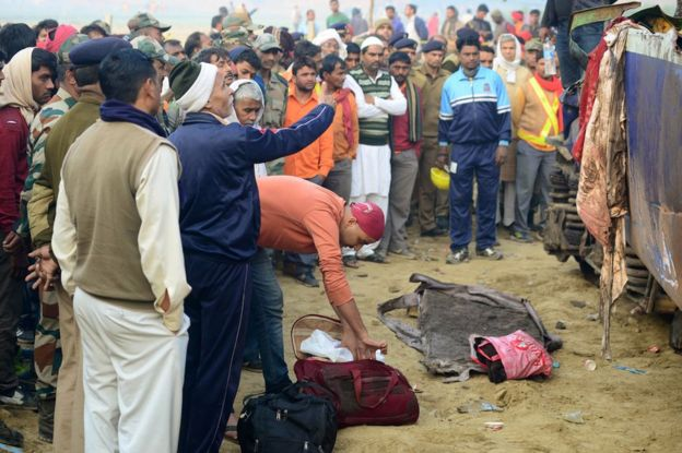 Relatives identify the luggage of a family member who was killed in a train accident in Kanpur on 21 November 2016, after a deadly train derailment.