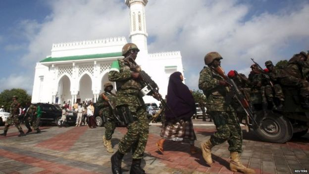 Soldiers serving in the African Union Mission in Somalia (AMISOM) patrol outside a mosque during Eid al-Fitr prayers 17/07/2015