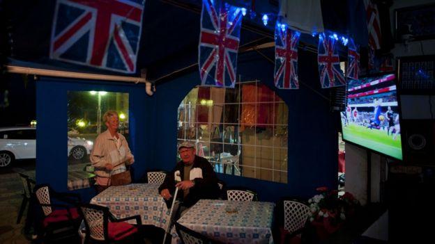 Elderly couple in British bar in Spain
