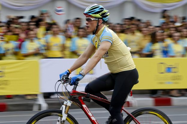A photo taken with slow shutter speed shows Thai Crown Prince Maha Vajiralongkorn cycling past well-wishers during the Bike for Dad, mass bicycle ride campaign held to celebrate the 88th birthday of Thai King Bhumibol Adulyadej in Bangkok, Thailand, 11 December 2015.