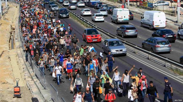 Migrants set off on foot for the border with Austria from Budapest, Hungary, September 4, 2015