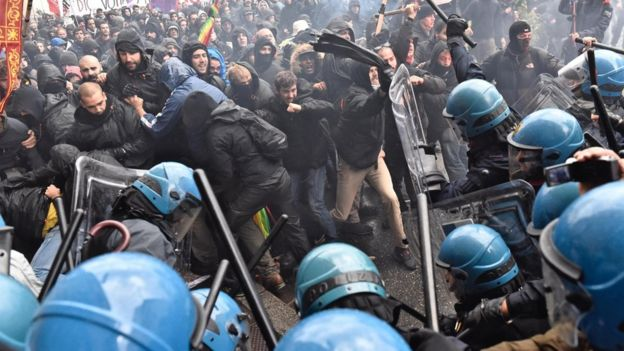 Demonstrators clash with police during a protest against Prime Minister Matteo Renzi, in Florence