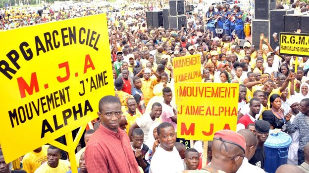 Supporters of 'The Rally of the Guinean People' (RPG) gather on August 11, 2015 in Conakry, Guinea