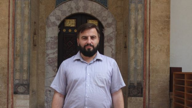 Adnan Ducic in front of the 16th century Gazi Husrev-bey Mosque in Sarajevo