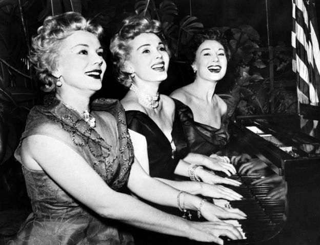 This file photo from January 1954 shows US actress Zsa Zsa Gabor (C) and her sisters Eva (L) and Magda, playing piano for new year day.