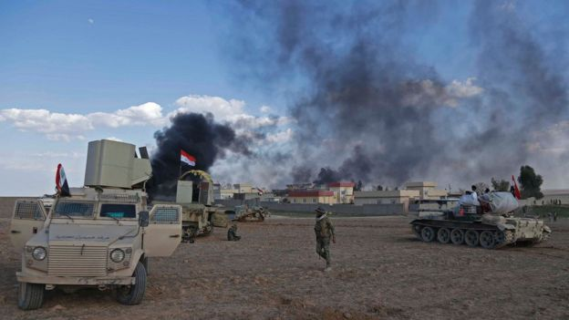 Iraqi government forces advance in the village of Badoush, some 15km northwest of Mosul, during the ongoing battle to retake the city's west from so-called Islamic State (IS), 8 March 2017