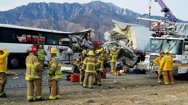 This photo provided by KMIR-TV shows the scene of crash between a tour bus and a semi-truck crashed on Interstate 10 near Desert Hot Springs, near Palm Springs, in California's Mojave Desert Sunday, Oct. 23, 2016.