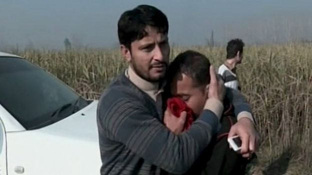 People react to the attack in Charsadda, Pakistan, 20 January