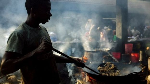 Mohammed Ismael cooks fish market at a stall on 27 September 2013 in Dar es Salaam
