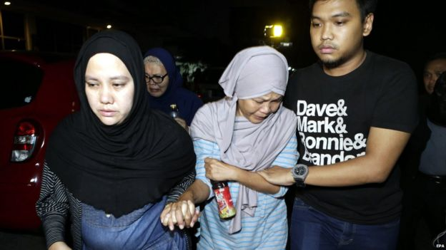 The mother of a missing Trigana Air plane crew member at the Trigana Air office, in Jakarta, Indonesia on 16 August 2015