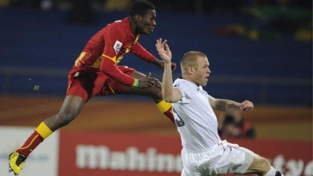 Ghana's striker Asamoah Gyan (L) scores against the USA during extra time of their 2010 World Cup round of 16 football match at Royal Bafokeng stadium in Rustenburg, South Africa, on June 26, 2010