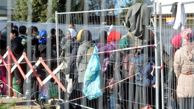 Migrants wait at a transitcamp in Salzburg, Austria, 6 November 2015
