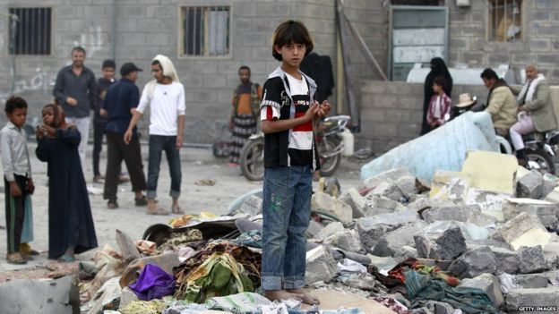 A young Yemeni boy stands amid the rubble following an air-strike by the Saudi-led coalition on the capital Sanaa on 13 July