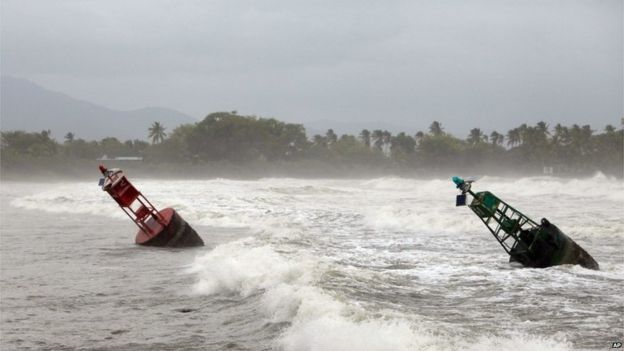 Two large navigation buoys hit by strong winds and waves, float near the coast, as Tropical Storm Erika moves away from the area in Guayama, Puerto Rico