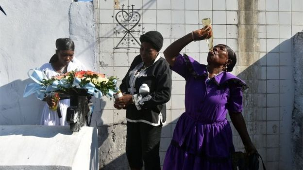 Voodoo followers take part in ceremonies honouring the Haitian voodoo spirits of Baron Samdi and Gede during Day of the Dead in a cemetery in Port-au-Prince, Haiti on November 1, 2015