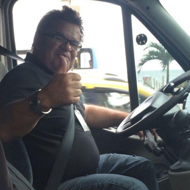 Carlos in his accessible taxi