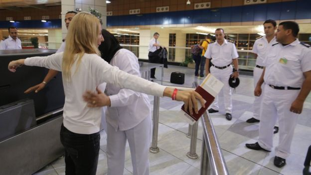 Egyptian security check Russian tourists as they depart from Sharm el-Sheikh airport. 5 November 2015