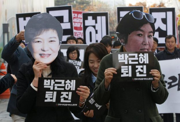 In this 18 November 2016, file photo, protesters wearing masks of South Korean President Park Geun-hye, left and Choi Soon-sil, Park's longtime friend, in Seoul, South Korea.
