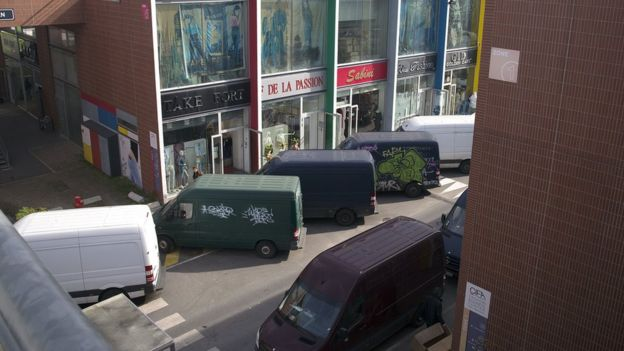 View of parked delivery vans and shops at the CIFA-Fashion Business Center