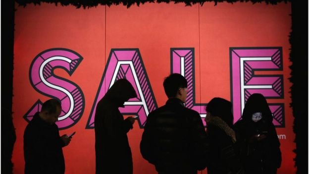 Shoppers queue outside Selfridges for the sale