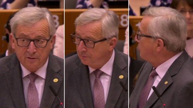 European Commission President Jean-Claude Juncker reacts during a speech in the European Parliament