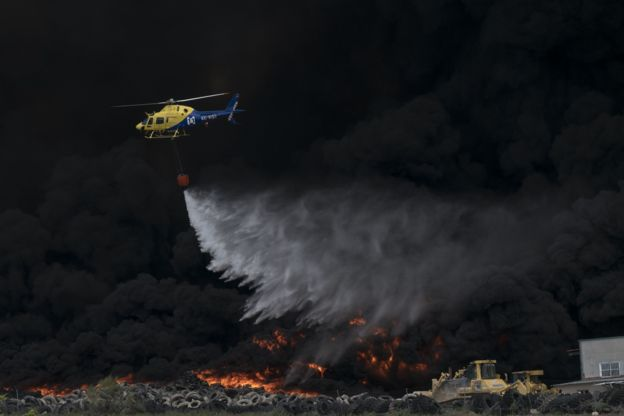 Helicopter over thick black smoke and flames, 13 May 2016