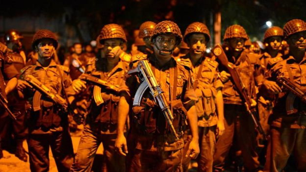 Bangladeshi security forces near restaurant attacked by unidentified gunmen in Dhaka. July 2, 2016