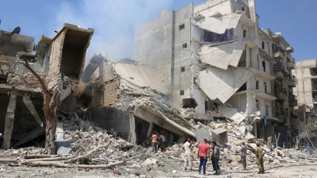 Men inspect a damaged site after double airstrikes on the rebel held Bab al-Nairab neighborhood of Aleppo on 27 August