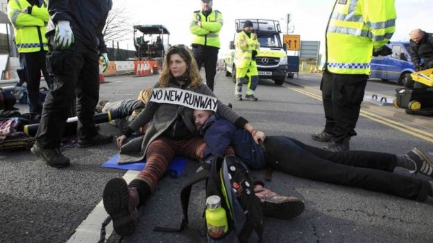 Environmental protestors block a road