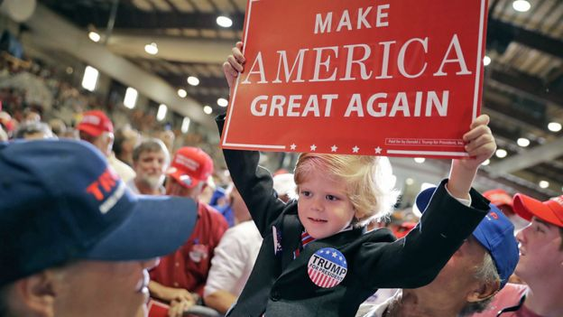 Six-year-old Eli Townsend dressed like Donald Trump at a campaign rally in Jacksonville, Florida - 3 November 2016