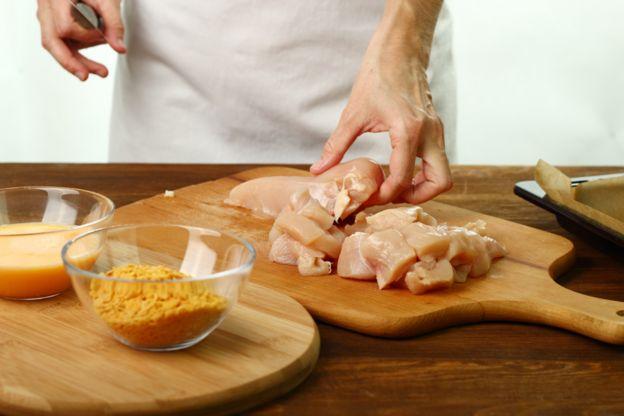 Person preparing chicken