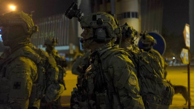 French and US soldiers gather before launching a counter-assault on Islamist gunmen at the Splendid Hotel in Ouagadougou