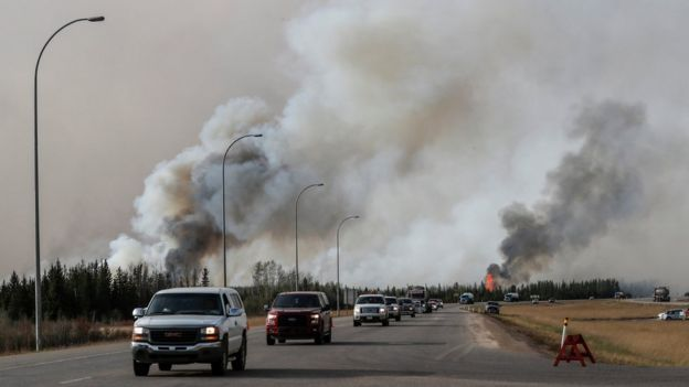 Convoy of vehicles pass wildfires - 6 May