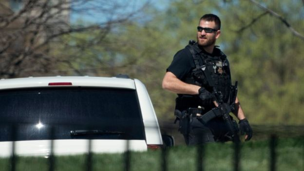 A US Secret Service Officer patrols the North Lawn during a brief precautionary lockdown of the White House