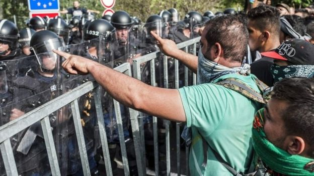 Refugees protest at the border station between Serbia and Hungary near Horgos, northern Serbia, 16 September 2015