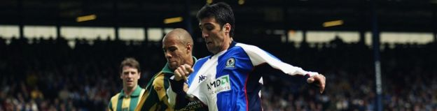 Hakan Sukur of Blackburn Rovers holds off James Chambers of West Bromwich Albion on May 3, 2003