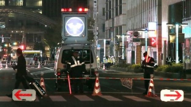Policemen stand guard on a street in Fukuoka after it was again temporarily closed over the weekend (26 November 2016)