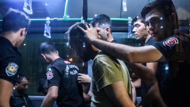 Turkish police detain a soldier in Istanbul on 16 July, 2016