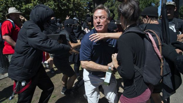 KCRA TV reporter Mike Luery runs from members of group called ANTIFA Sacramento (Anti-Fascism Action). 26 June 2016