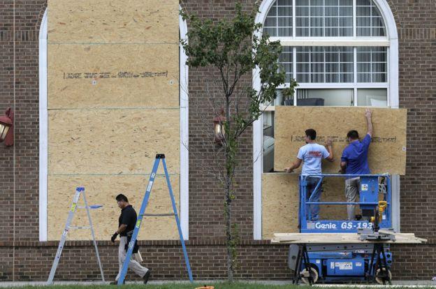 Men repair windows in Charlotte