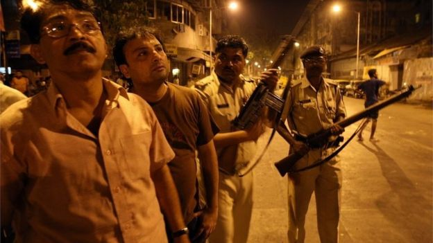 Indian policemen prepare to take position at the site of attack in the Colaba area of Mumbai on November 27, 2008.