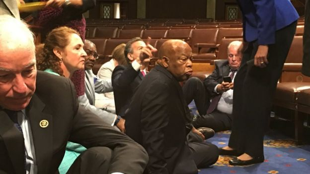 Photo showing Democrat members of Congress, including Democratic Rep John Lewis, (centre) in sit-down protest seeking a a vote on gun control measures, Wednesday, 22 June 2016