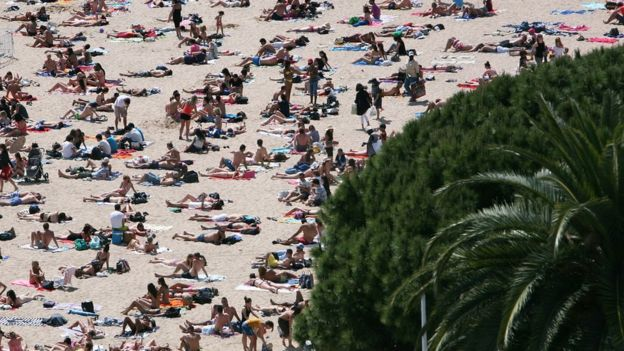 People sunbathing on the beach in Cannes