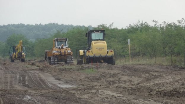 Diggers prepare land for the border fence