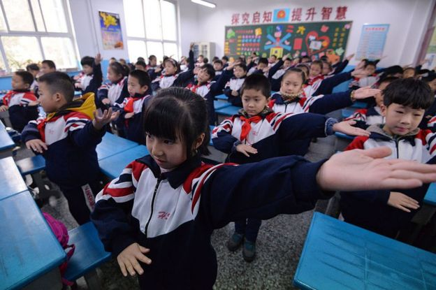 Pupils do exercise in the classroom as heavy smog hits Hebei on 19 December 2016 in Handan, Hebei Province of China. Schools cancel outdoor activities as heavy smog hits Handan.