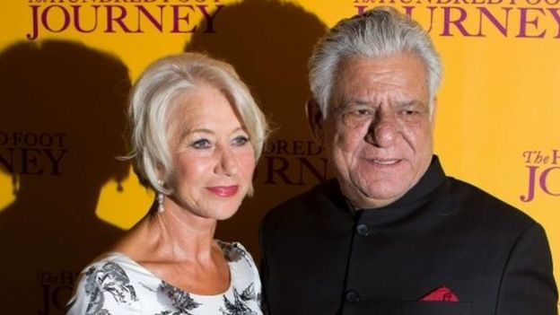This file photograph taken on September 3, 2014, shows Indian Bollywood actor Om Puri (R) posing with British actress Helen Mirren (L) as they attend the UK Gala Screening of the film, The Hundred Foot Journey,