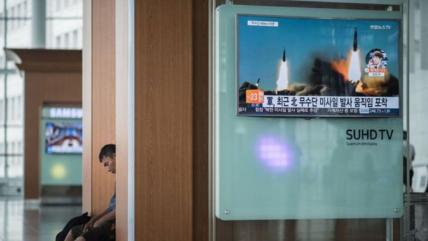 A television screen broadcasts news coverage of a North Korean rocket launch, at Seoul station on June 22, 2016.