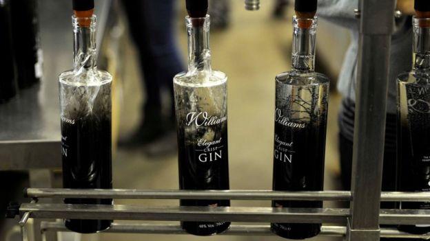 Gin bottles being filled