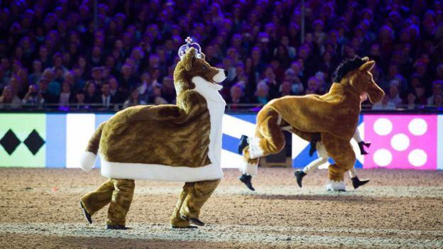 A pantomime horse and a pantomime corgi
