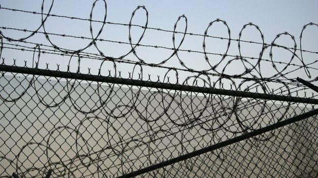 Barbed perimeter wire at Santa Barbara prison, California